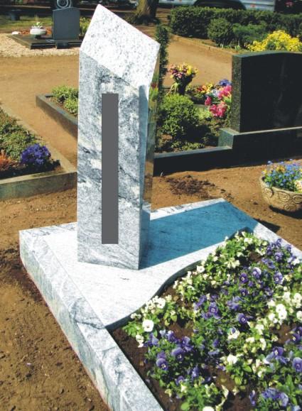 Steinmetz Grabsteine Magdeburg - bezahlbares, aber schönes Einzelgrab aus weiß-grauem Gneis vom Steinmetzmeister